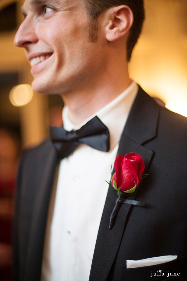 red rose boutonniere at black tie wedding