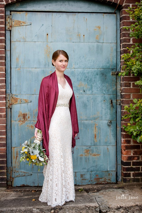 bride in front of the blue door at the lace factory